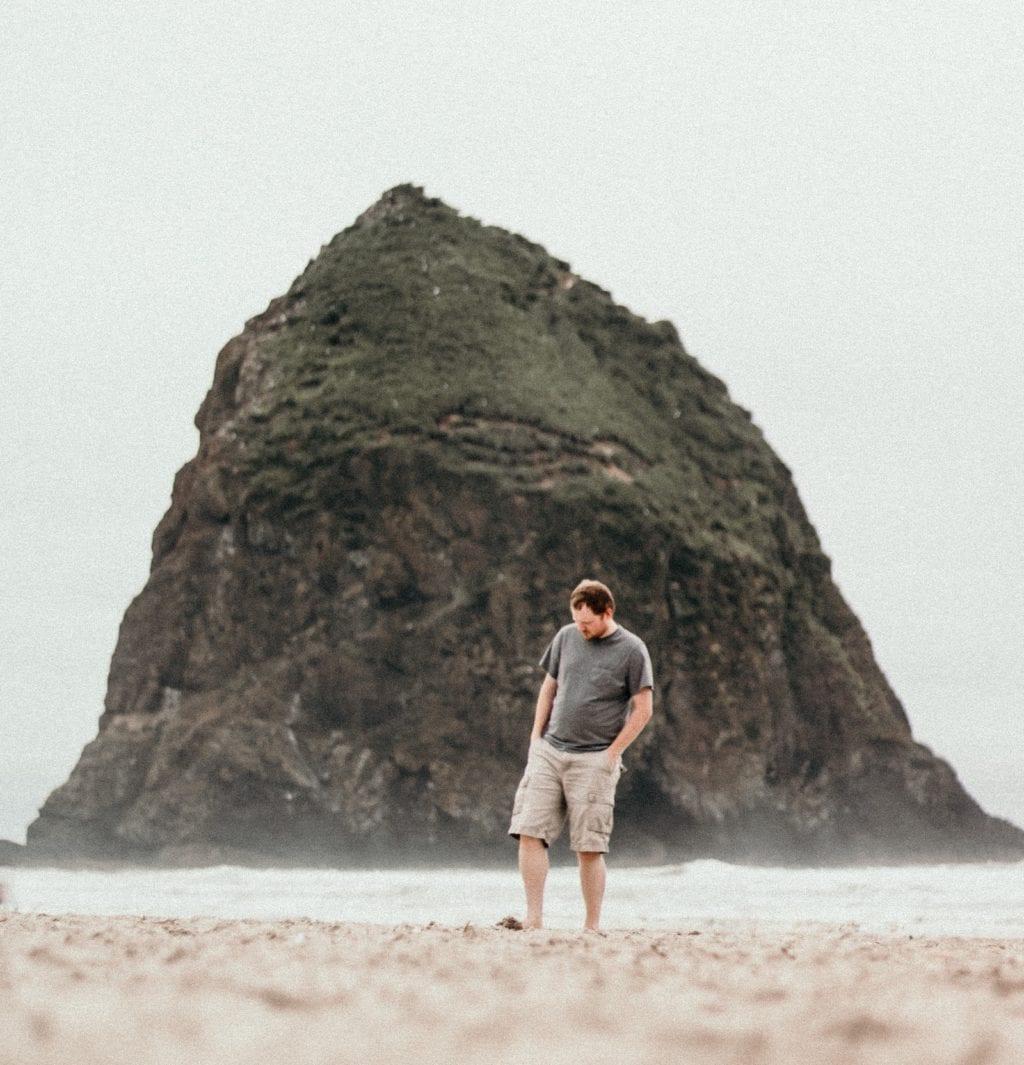 man walking on the beach meditation for depression