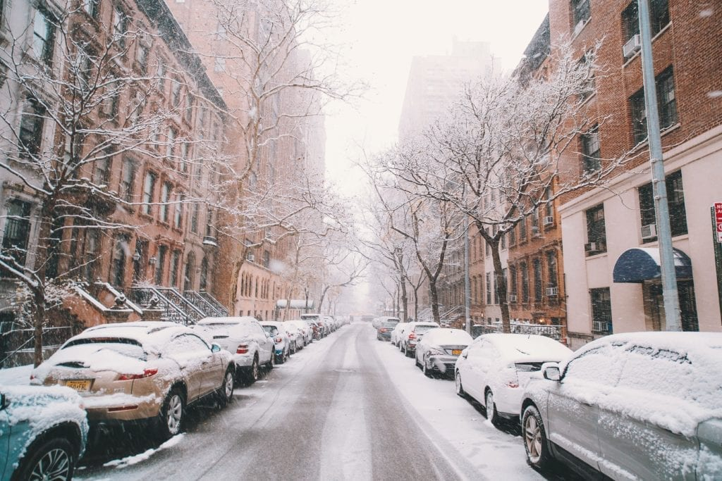 Snow covering the streets, causing seasonal depression.