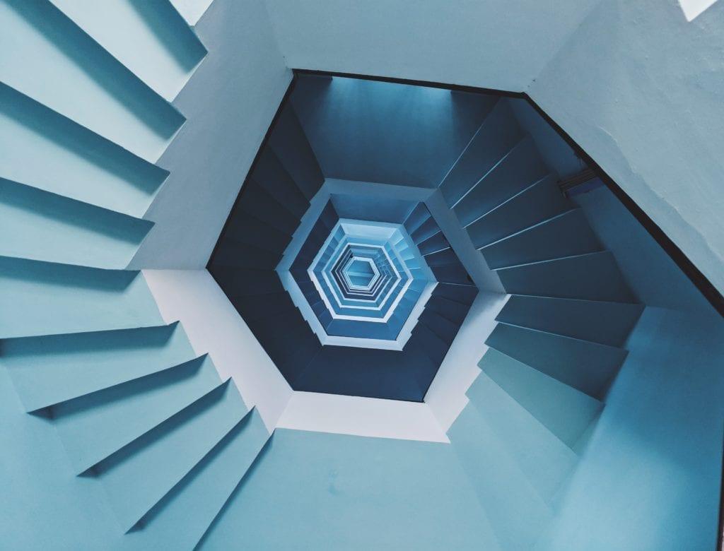 Blue spiral stairs symbolizing anxious rumination.