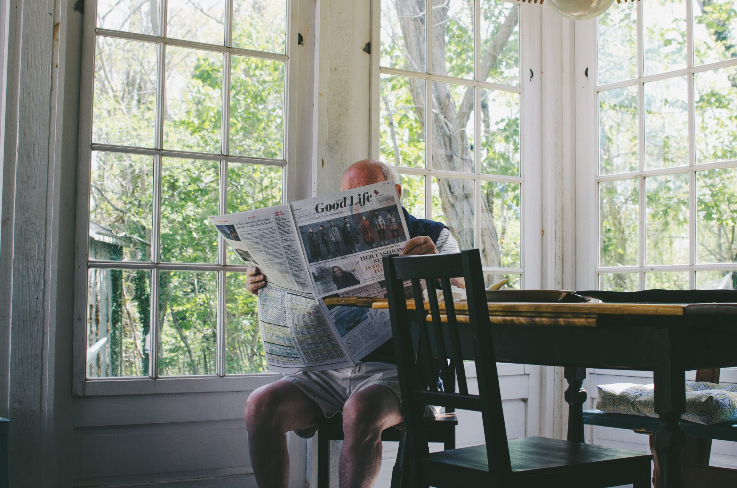 Man with low testosterone reading a newspaper