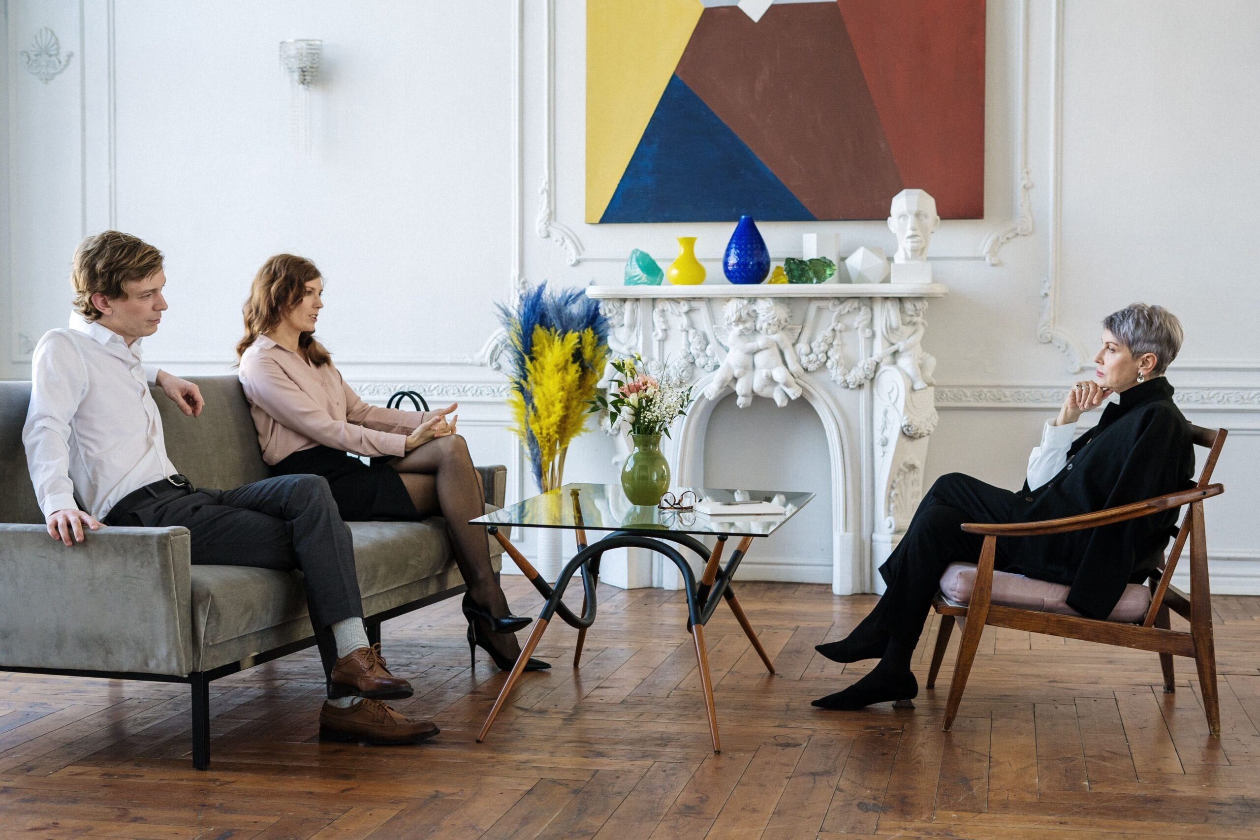 couple sitting down with therapist