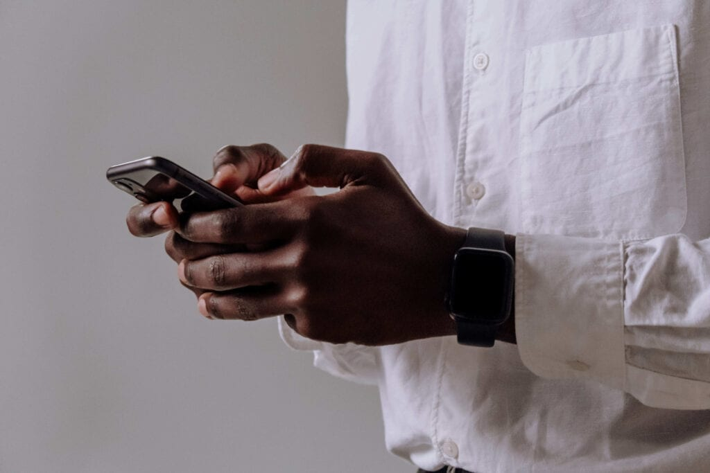Man using phone for online therapy